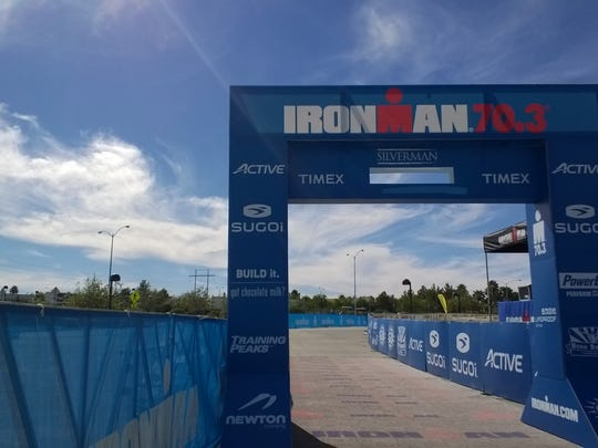 Workers put the finishing touches on the Ironman 70.3 Silverman finishing shoot on Saturday.
