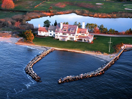 Katharine Hepburn's Old Saybrook home with a private beach on the Long Island Sound, previously listed at $28 million, is now priced at $14.8 million.