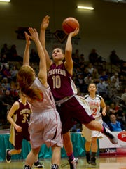 Choteau's Megan Krone extends for a basket during Choteau's first-round match against Manhattan during the 2015 State B Basketball Tournament.