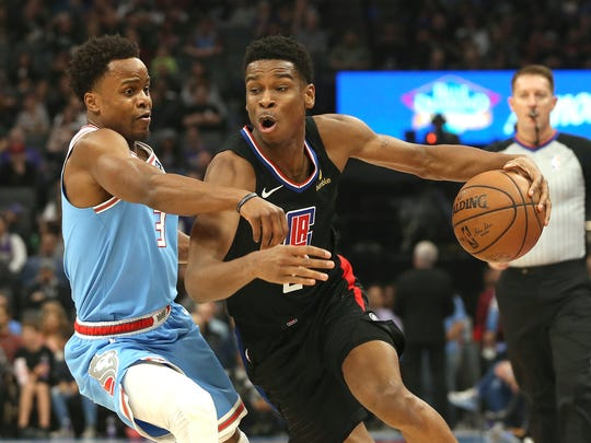 Sacramento Kings guard Yogi Ferrell, left, tries to stop the drive of Los Angeles Clippers guard Shai Gilgeous-Alexander during the first quarter of an NBA basketball game in Sacramento, Calif., Friday, March 1, 2019. (AP Photo/Rich Pedroncelli)