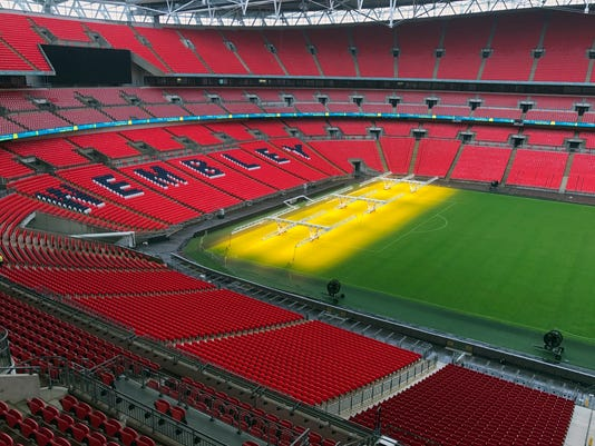 This photo taken on Wednesday, Aug. 9, 2017 shows a general view of Wembley Stadium in London. English soccer's national stadium will stage Premier League matches for the first time, giving the competition its biggest-ever crowds. Tottenham will be moving into the 90-000-capacity Wembley for the season while a new stadium is built at its White Hart Lane home 12 miles (19 kilometers) across north London. (AP Photo/Rob Harris)