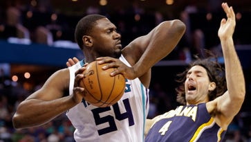 Charlotte Hornets forward Jason Maxiell (54) grabs a rebound over the Indiana Pacers' Luis Scola on Feb. 8, 2015.
