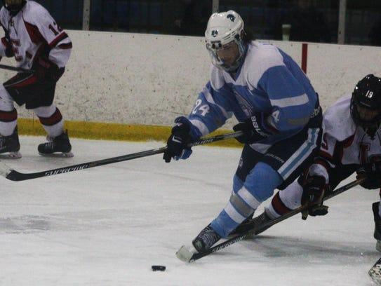 Shane Leonard steers the puck toward the net.