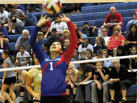 Jaime Guzman for the Sun-News   Las Cruces High's Amber Saiz prepares to set a teammate against Ruidoso High on Tuesday night at Las Cruces High School.