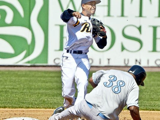 Wilson Valdez (top) had four hits in the York Revolution's 8-7 victory over Bridgeport on Sunday.