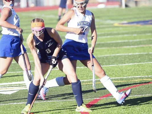 Chambersburg's Liza Ernst (8) is defended by Katie Wise (21) of Waynesboro on Wednesday. Ernst finished with three assists to help the Trojans to a 7-0 win.