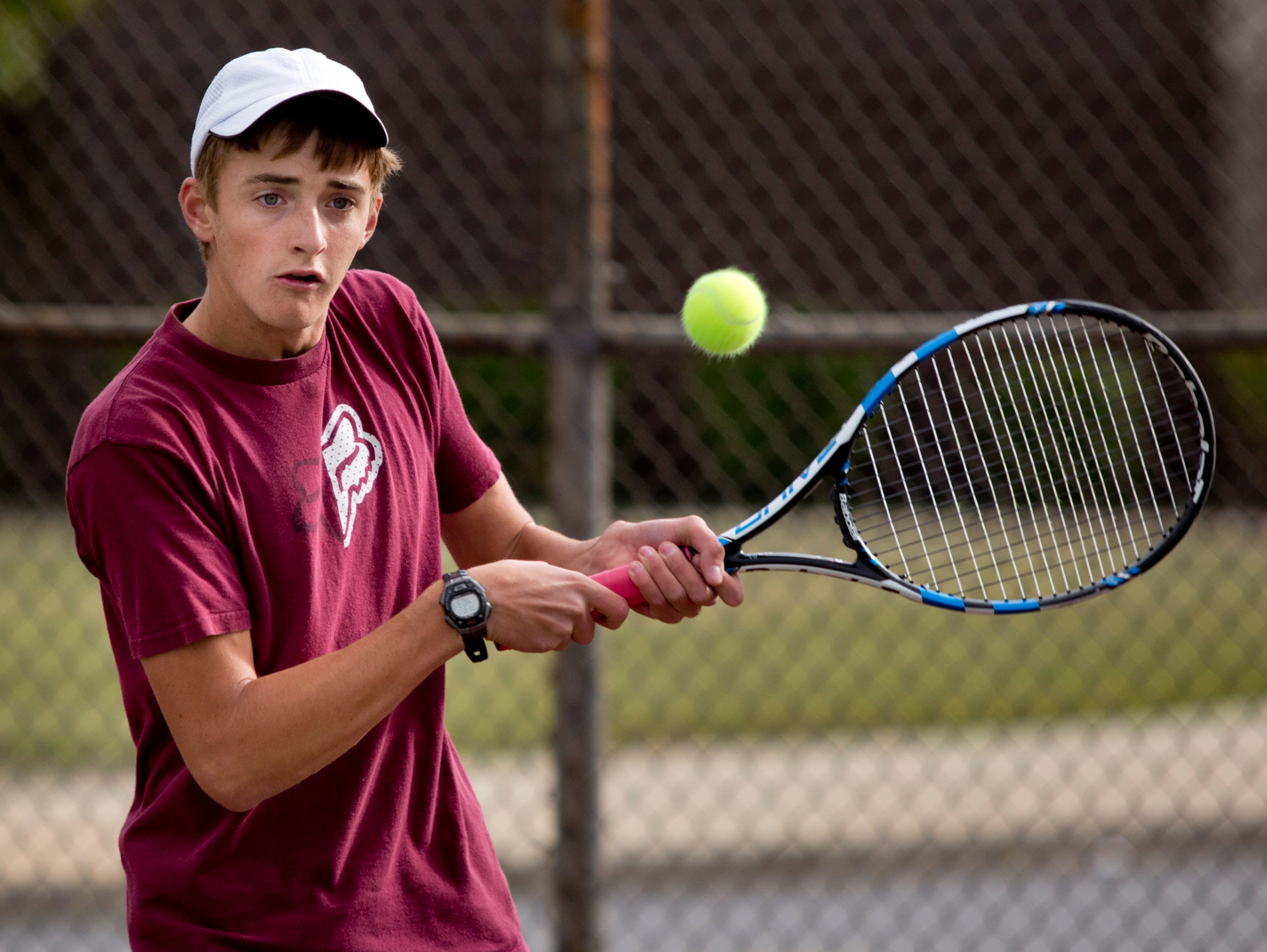 Junior Devon LaHaie returns the ball during tennis practice Tuesday, October 13, 2015 at Armada High School.