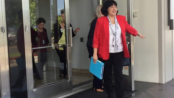 Attorney General Elizabeth Barrett-Anderson leaves the District Court of Guam on April 13, 2017 after Chief Judge Frances Tydingco-Gatewood dismissed a 25-year-old settlement agreement regarding Guam's prison.