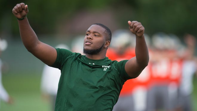 Linebacker Deonte Clyburn tries to motivate his teammates during warm-up exercises Thursday, the first day of practice for the CSU football team for the 2016 season. Clyburn will have to sit out the season while on medication for a blood clot, coach Mike Bobo said Saturday.