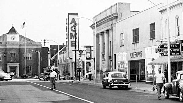 With its corner tower jutting skyward, the 1950 Acme building is seen at the corner of Main and High streets in Millville. It was razed in the 1970s.