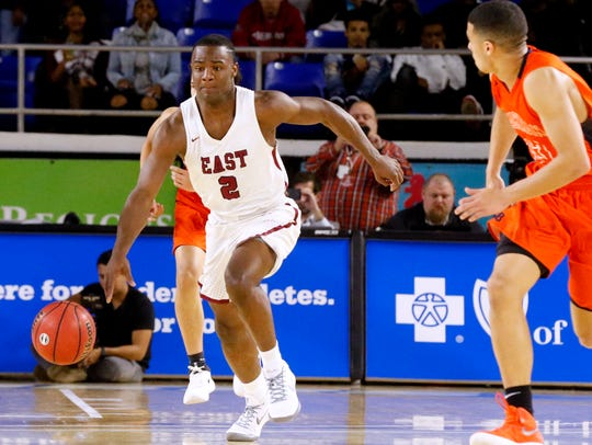 Memphis East's Alex Lomax (2) moves the ball down the court against Blackman in the quarterfinals of the boys state basketball tournament last season.