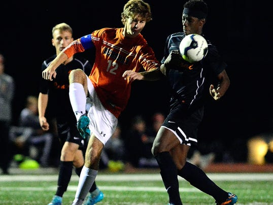 Hershey's Nick Oggero kicks the ball away from Central York's Igor Gomes during a District 3 boys' soccer semifinal at Northeastern on Tuesday. Gomes had a goal and an assist in Central's 2-1 win.