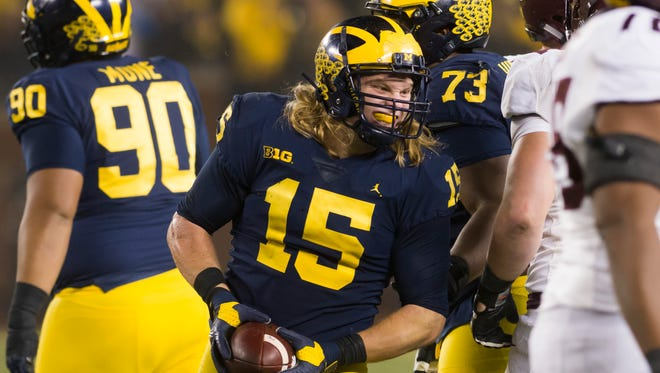 Defensive lineman Chase Winovich is mulling whether to return to Michigan for a final season or head to the NFL.