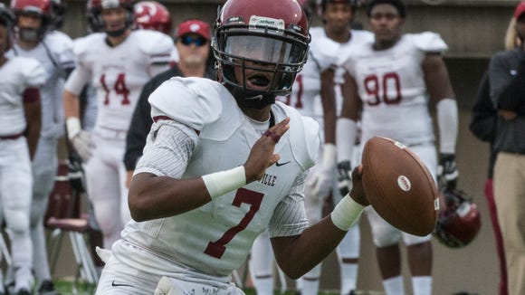 Prattville quarterback Josh Moore looks for a receiver. The visiting Prattville Lions defeated Jefferson Davis 38-20 on Saturday, Oct. 3, 2015, at Cramton Bowl in Montgomery.