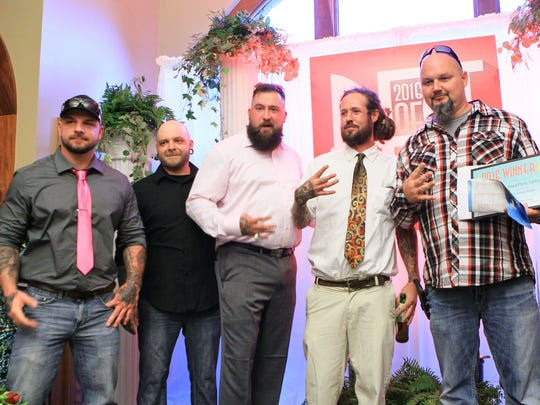 "Shannon Bridge (left), Nick Sullivan, Connor Kirkland, Keith Freelin and ""Redneck"" hold up four fingers as Painted Pony Tattoo won Best Tattoo Parlor during the Best of Hometown Anderson at the Bleckley Inn in downtown Anderson. It was the salons fourth year in a row winning the category."
