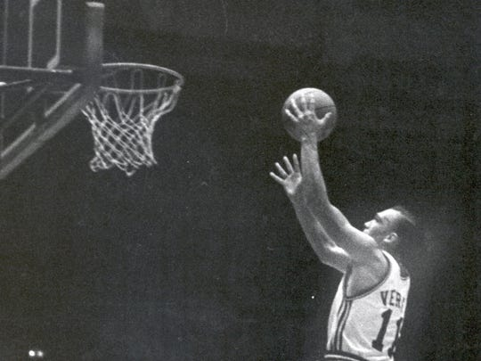 Former St. Rose star Bob Verga drives for a layup as