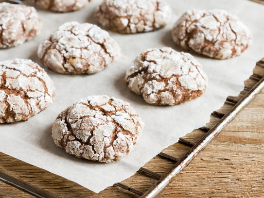 Chocolate pixies are rolled in powdered sugar before