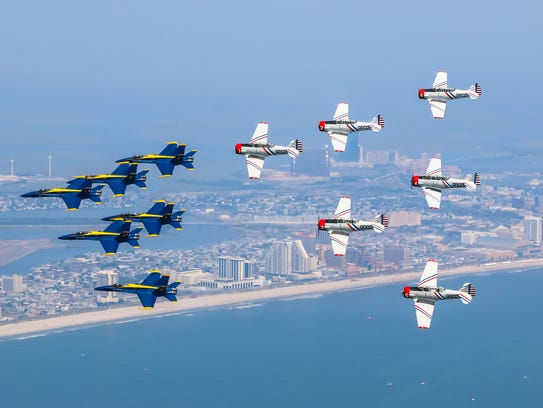 The GEICO Skytypers team is shown in a joint formation