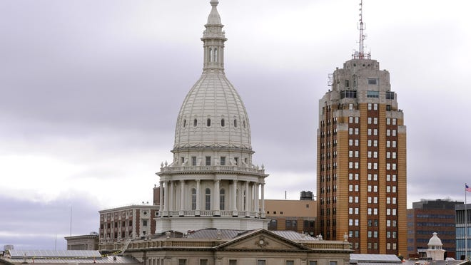 The state Capitol building and Boji Tower are pictured in this view of downtown Lansing.
