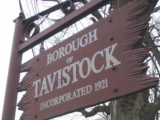 A vehicle drives along Tavistock Lane while entering