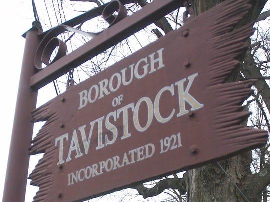 A vehicle drives along Tavistock Lane while entering Tavistock, NJ.