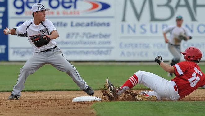 Anthony Reyes from Twin Lakes makes the play on second and immediately takes aim for a double play as Hoosier North and the Monticello Tribe face off in the Harry Bradway Classic, Sunday, July 31, 2016.