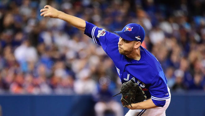 Marco Estrada delivers during the first inning of Game 5 on Wednesday.