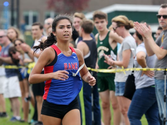 Carmel's Jade Sessions on her way to winning the girls
