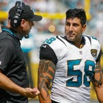 Sep 29, 2013; Jacksonville, FL, USA; Jacksonville Jaguars defensive line coach Todd Wash talks to defensive end Jason Babin (58) in the second quarter of their game against the Indianapolis Colts at EverBank Field. The Indianapolis Colts beat the Jacksonville Jaguars 37-3. Mandatory Credit: Phil Sears-USA TODAY Sports