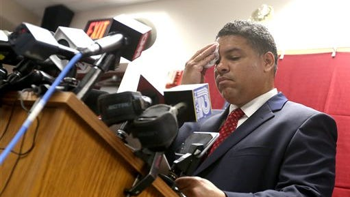 Dane County District Attorney Ismael Ozanne speaks during a press conference at the Dane County Public Safety Building in Madison, Wis. Tuesday, May 12, 2015. Ozanne said  that Madison police officer Matt Kenny would not face charges in the shooting death of 19-year-old Tony Robinson in March 2015. (John Hart/Wisconsin State Journal via AP)