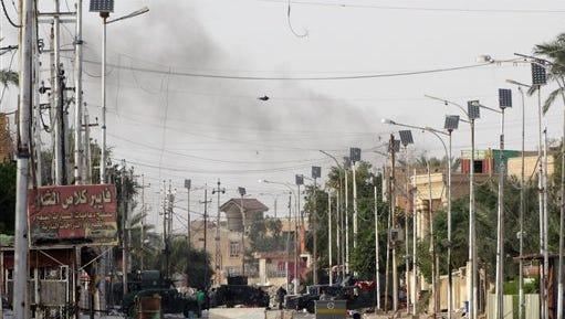 In this Saturday, May 9, 2015 photo, Iraqi security forces patrol as US army air force aircrafts attack Islamic State group positions in an eastern neighborhood of Ramadi, the capital of Anbar province, 70 miles (115 kilometers) west of Baghdad, Iraq. Iraqi authorities on Friday signed up the first batch of 1,000 recruits for a new Sunni militia to help its security forces take back the western Anbar province from the Islamic State group, after years of reluctance to arm and train the tribal fighters. (AP Photo)