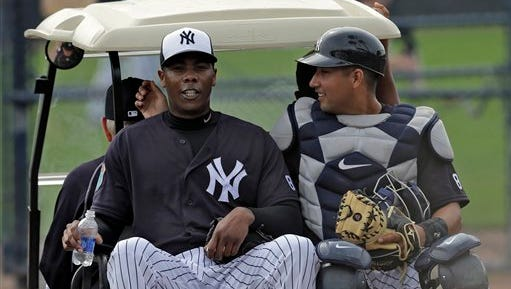 New York Yankees relief pitcher Aroldis Chapman rides in a golf cart with catcher Francisco Diaz before a spring training baseball game against the Philadelphia Phillies Thursday, March 3, 2016, in Tampa, Fla. (AP Photo/Chris O'Meara)