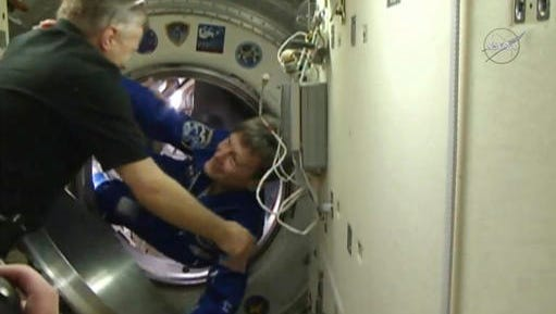 In this image made from video provided by NASA, astronaut Peggy Whitson boards the International Space Station on Saturday, Nov. 19, 2016. This is the third space station mission for Whitson, who at 56 is older than each of her crewmates.