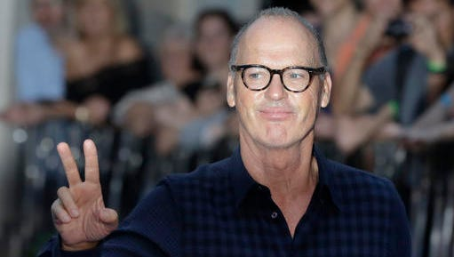 """FILE - In this Sept. 15, 2016, file photo, actor Michael Keaton poses for photographers upon arrival at the world premiere of the film 'The Beatles, Eight Days a Week' in London. Keaton told   The Hollywood Reporter's """"Awards Chatter"""" podcast released Tuesday, Jan. 3, 2016, that he left the Batman franchise because  the script for the third film in the series """"sucked"""" and """"never was good."""" (AP Photo/Kirsty Wigglesworth, File)"""