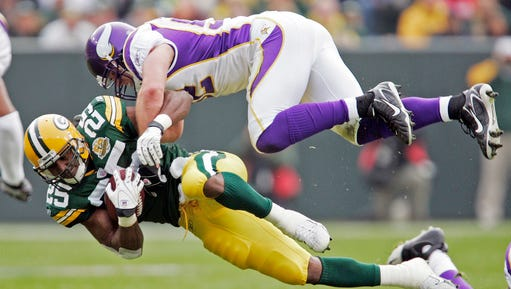 In this Nov. 11, 2007, file photo, Green Bay Packers running back Ryan Grant (25) is hit by Minnesota Vikings linebacker Chad Greenway (52) during the first half of an NFL football game in Green Bay, Wis. Greenway is retiring.