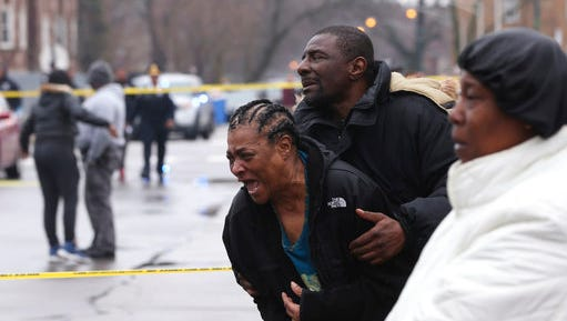 Georgia Jackson, 72, is overcome with emotion upon learning that her two grandsons, Raheem, 19, and Dillon Jackson, 20, were found fatally shot in the South Shore neighborhood in Chicago on Thursday, March 30, 2017. Chicago police said Thursday several people were found fatally shot Thursday in or near a restaurant.