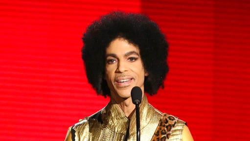 FILE - In this Nov. 22, 2015, file photo, Prince presents the award for favorite album - soul/R&B at the American Music Awards in Los Angeles.  Prince died at his home in Chanhassen, Minn. on April 21, 2016 at the age of 57.
