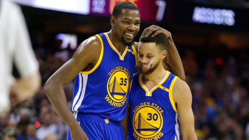 Kevin Durant, left, and Stephen Curry have led the Warriors to the past two NBA titles.
