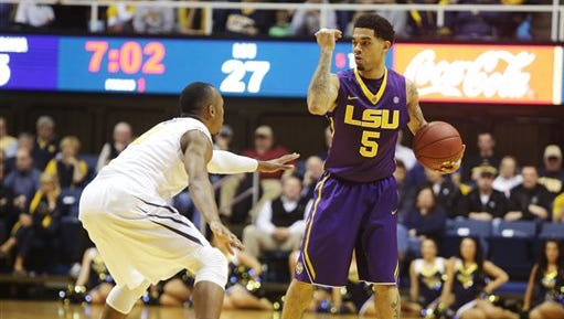 LSU guard Josh Gray (5) signals a play while being defended by West Virginia guard Jevon Carter (2) during Thursday's game.