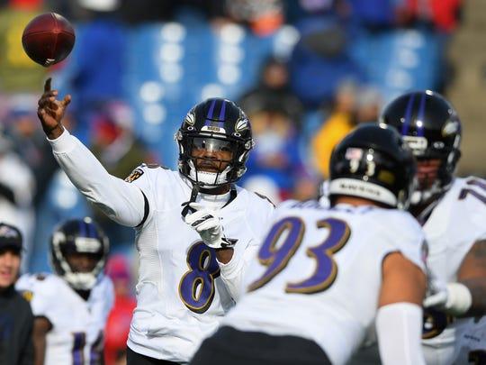 Dec 8, 2019; Orchard Park, NY, USA; Baltimore Ravens quarterback Lamar Jackson (8) warms up prior to the game against the Buffalo Bills at New Era Field. Mandatory Credit: Rich Barnes-USA TODAY Sports