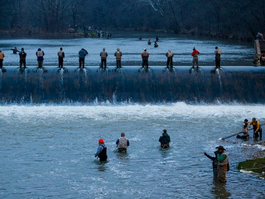 Anglers cast their lines from atop the dam at Bennett