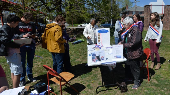 A voting registration drive hosted by the League of Women Voters Henderson County in 2018.