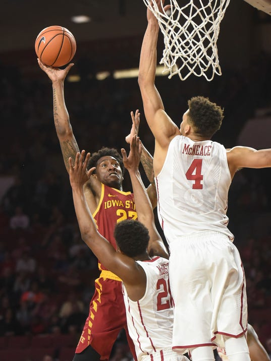 Iowa State's Zoran Talley Jr (23) shoots over Ou's Kameron McGusty (2) and Jamuni McNeace (4) in the first half of an NCAA college basketball game Friday, March 2, 2018, in Norman, Okla. (AP Photo/Kyle Phillips)