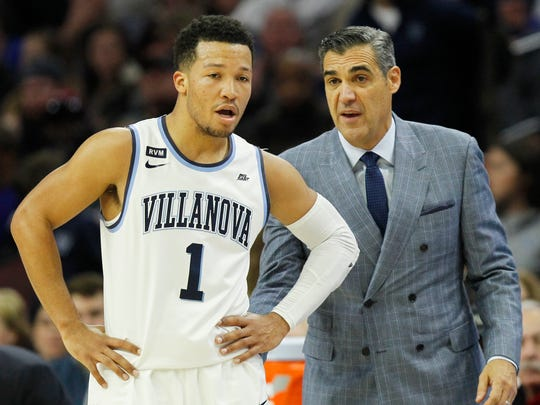 Villanova head coach Jay Wright talks to guard Jalen Brunson (1) during the first half of an NCAA college basketball game against La Salle, Sunday, Dec. 10, 2017, in Philadelphia. (AP Photo/Laurence Kesterson)