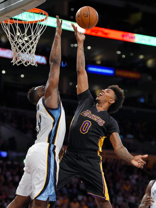 Los Angeles Lakers forward Nick Young, right, shoots as Memphis Grizzlies forward P.J. Hairston defends during the first half of an NBA basketball game Friday, Feb. 26, 2016, in Los Angeles. (AP Photo/Mark J. Terrill)