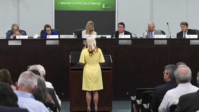 Members of the Brevard County legislative delegation listen to a presentation by Brevard County Supervisor of Elections Lori Scott.