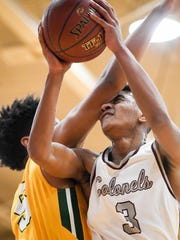 Henderson's Daymien Dixon (3) is fouled by University