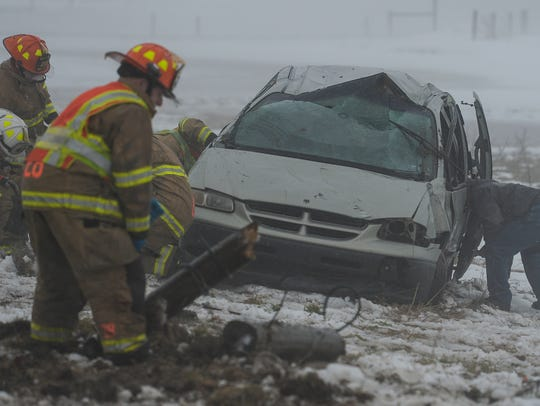 Emergency crews work at the scene of a single vehicle