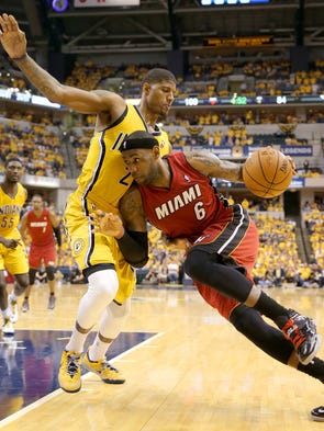 Pacers forward Paul George tries to stop Miami Heats forward LeBron James from driving to the baseline during the second half of action.