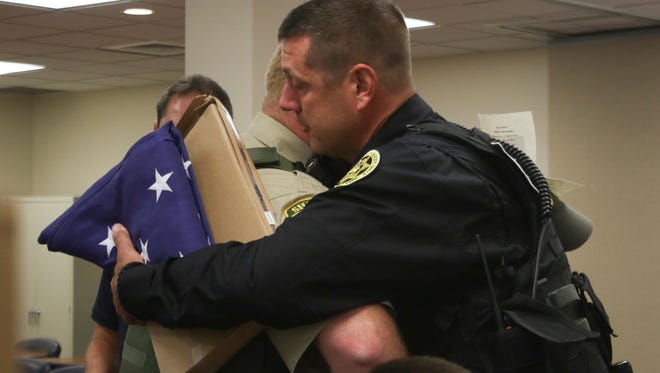Cheatham County deputy Jacob Kent, left, hugs Montgomery County deputy Dale BeCraft during a memorial service for MCSO K9 Titan on Friday. Kent was Titan's handler before leaving Montgomery County Sheriffs Office and BeCraft was his last handler.